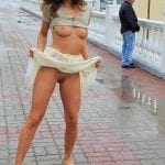 Ebony whore panties aside flashing in the public street