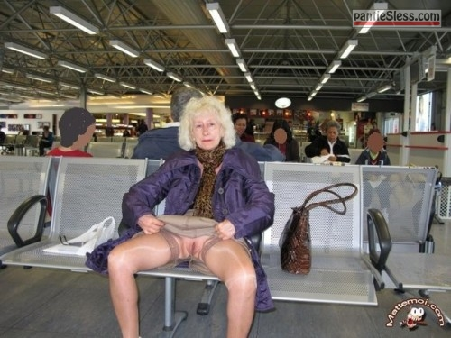upskirt public flashing mature bottomless blonde Swedish granny flashing cunt at the airport