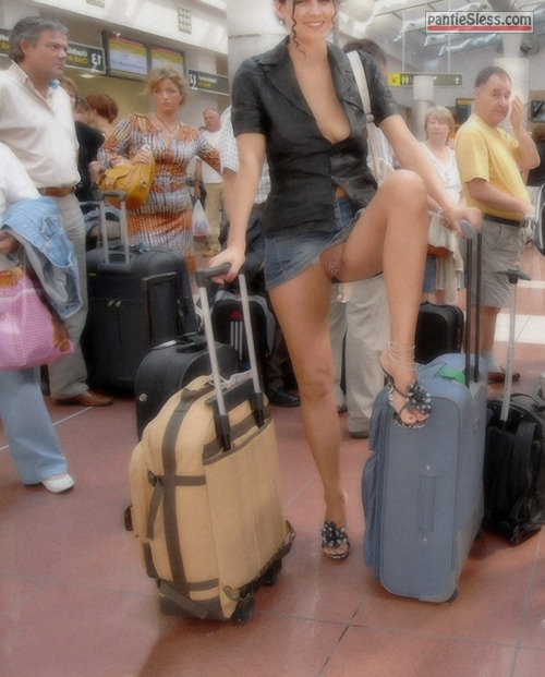 upskirt pussy flash public flashing milf hotwife bottomless Knickerless hotwife in high heels posing at the airport