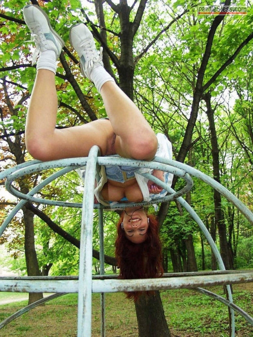 underboob shaved pussy redhead pussy flash public flashing bottomless boobs flash  Underwear less redhead having fun at kids playground