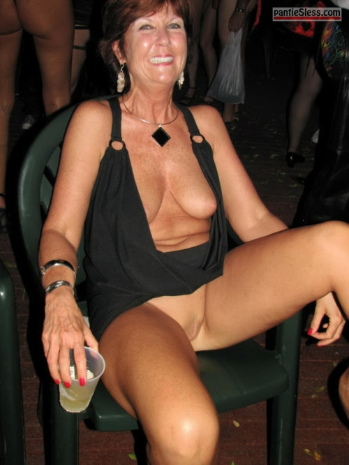 shaved pussy pussy flash public flashing nip slip mature hotwife bottomless boobs flash  Mature lady happy to take part at nude beach night party