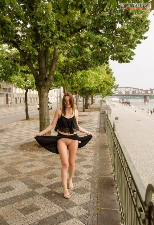 upskirt shaved pussy pussy flash public flashing brunette bottomless Lifting up her black skirt while walking pantyless on riverside