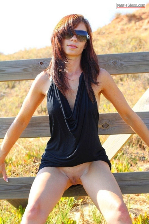 shaved pussy pussy flash public flashing brunette bottomless  Slender lady with sunglasses posing