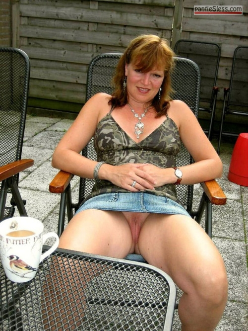 upskirt shaved pussy redhead pussy flash public flashing mature hotwife bottomless  Mature redhead has nothing under denim mini skirt