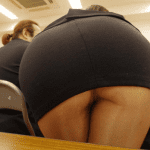 Hot teacher after work spreading legs on green bench near school