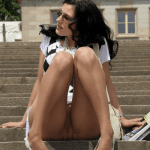 Upskirt panties while she is reading newspaper