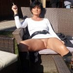Mature  MILF in black slutty stocking bending over pantyless