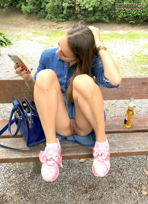 shaved pussy pussy flash public flashing hotwife dark haired brunette bottomless  Texting on bench bottomless drinking a beer