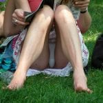 Good looking mature blonde knickerless in park