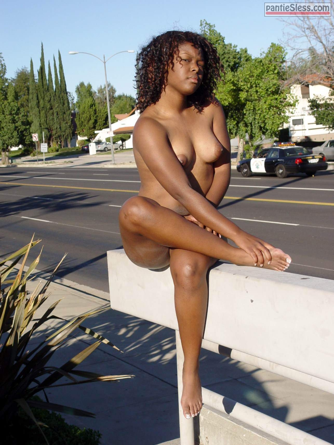 prostitute nudes ebony Totally naked black bitch posing nude next to the police car
