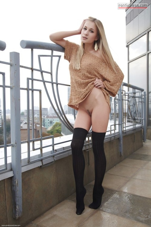 trimmed pussy teen pussy flash public flashing bottomless blonde babes Knickerless golden hair girl in black stockings on the top of building