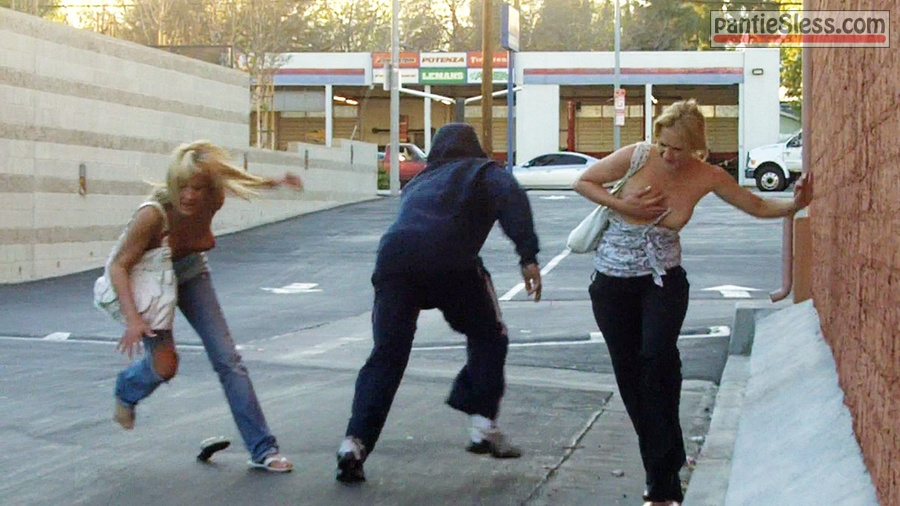 sharking public flashing milf boobs flash blonde accidental flash Two blonde ladies got their boobs sharked by criminal