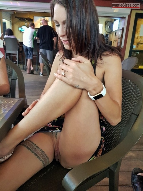 upskirt pussy flash public flashing hotwife brunette bottomless accidental flash  Wife with tattooed garter pantie less in cafe