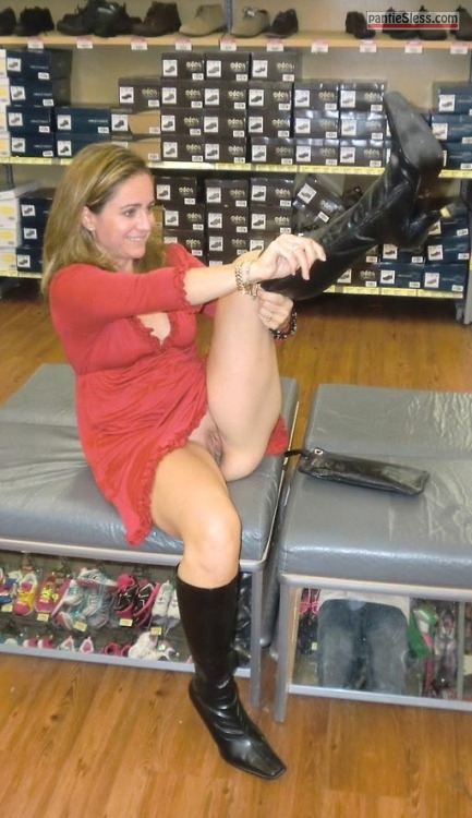 upskirt trimmed pussy pussy flash public flashing milf hotwife bottomless blonde  Knickerless mom in red dress trying out new boots at shop