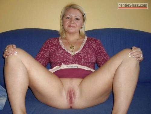 shaved pussy pussy flash milf mature bottomless blonde  Blonde MILF is spreading her legs wide on blue sofa