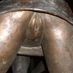 Bronze statue of panty-less upskirt girl
