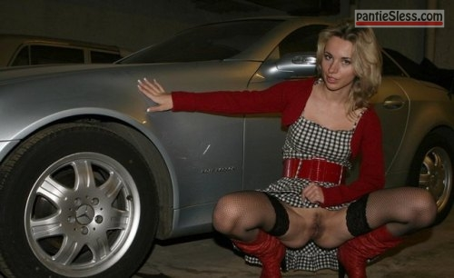 bottomless Showing off her awesome sports car,