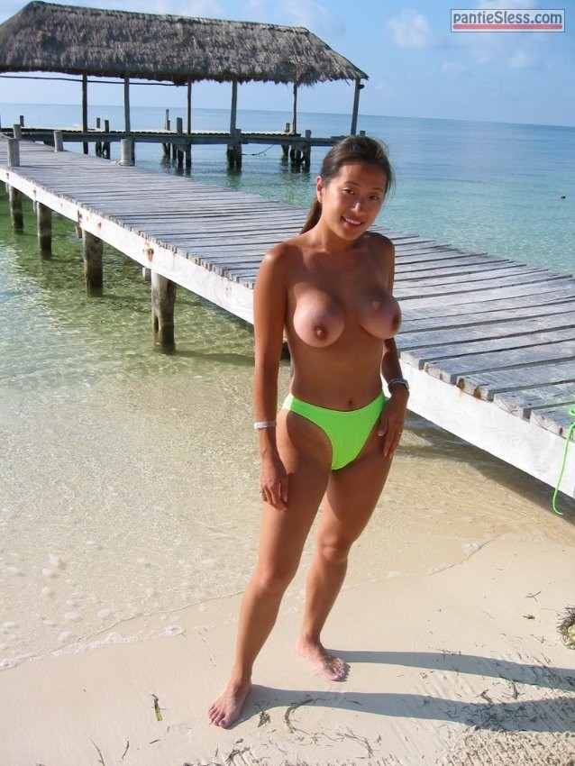 public flashing nude beach milf hotwife dark haired boobs flash asian Chinese MILF with big tits topless on beach